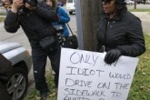 """Cleveland Woman to Hold """"Idiot"""" Sign for Traffic Offense Image 1  Image 2  Image 3  Image 4"""