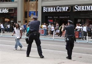 Crowds Witness NYPD Officers Shooting Armed Suspect Near Times Square