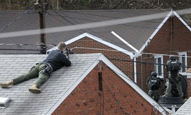 Gunman 'lying in wait' kills 3 Pittsburgh officers