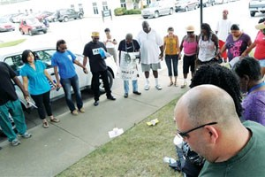 Police Video Tries to Reconstruct Handcuffed Shooting