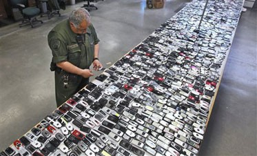 Prisons press fight against smuggled cell phones