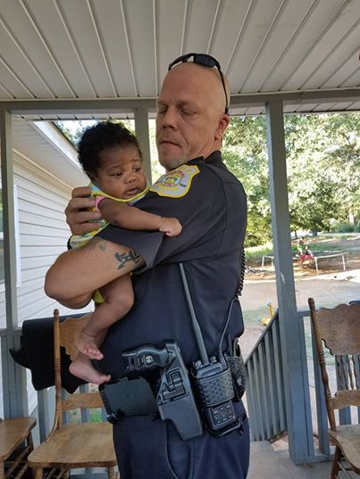 Family Asks Cop To Be Baby's Godfather After He Saves Her From Choking