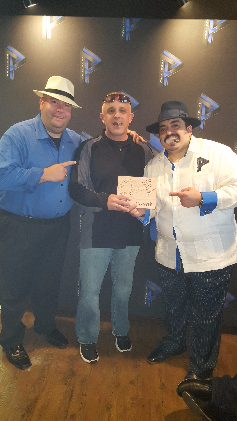 Detective L.O. surrounded by Cigar Gods Bill Ives (right) and Juan Cancel (left)