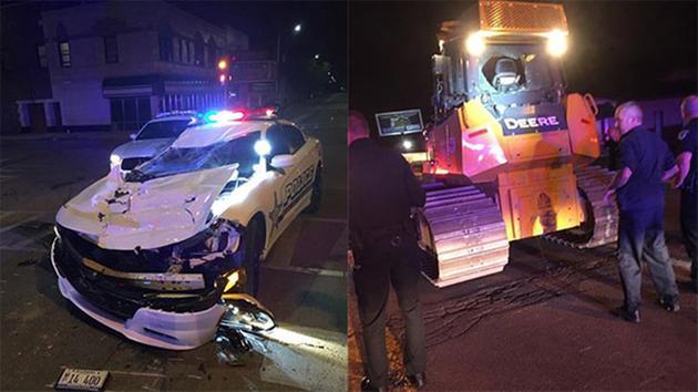 Man Backs Over Police Car With Bulldozer