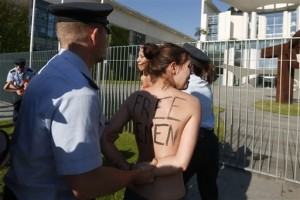 German Police Breakup Topless Feminist Protest