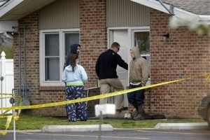 Investigators Seek Cause in Illinois Homicides