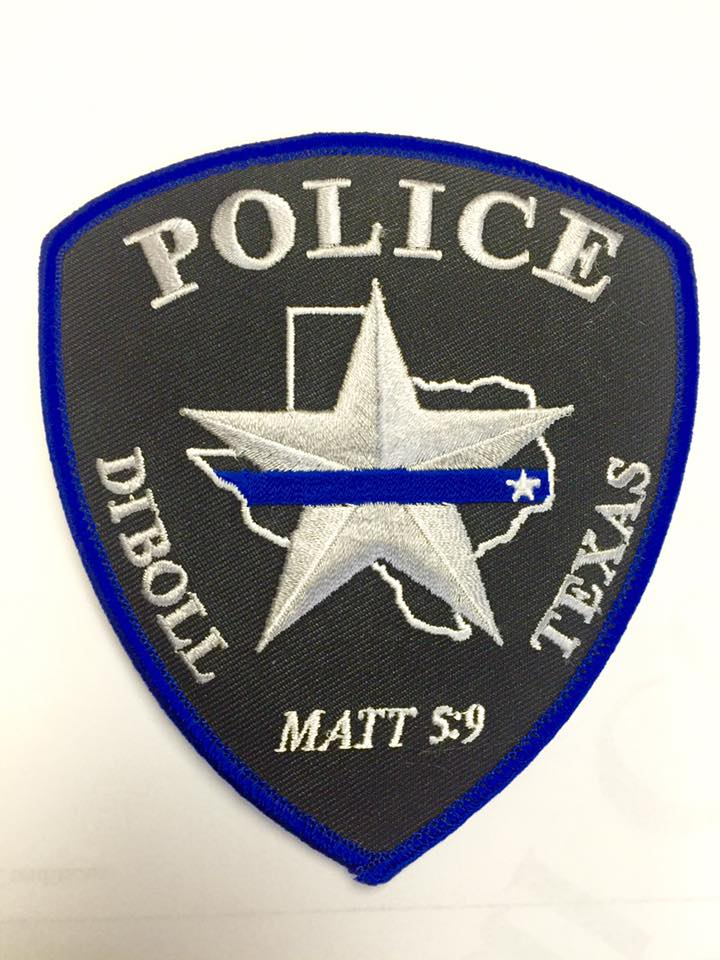 Police Patch With Scripture Nixed