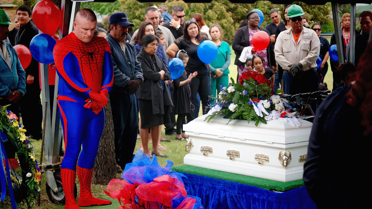 police officer dresses as spiderman at boy s funeral law officer