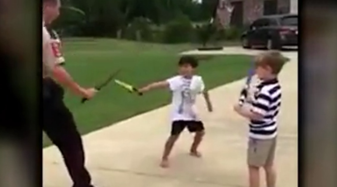 Video: Police Officer Sword Fights Children