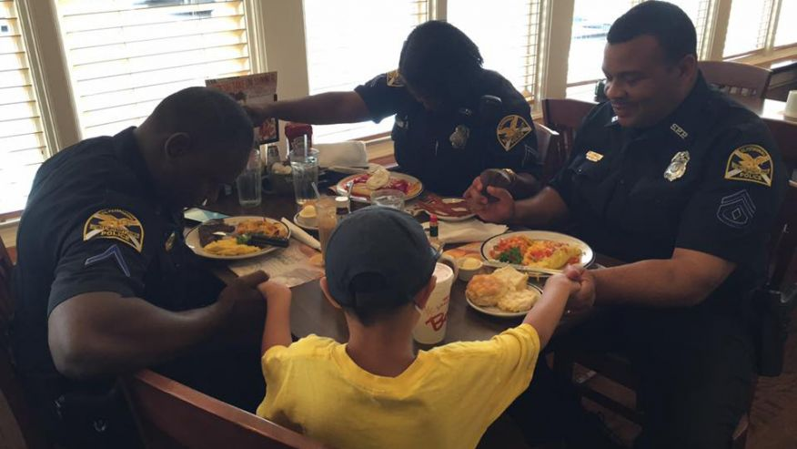 Powerful Photo Shows Boy Praying With Police Officers