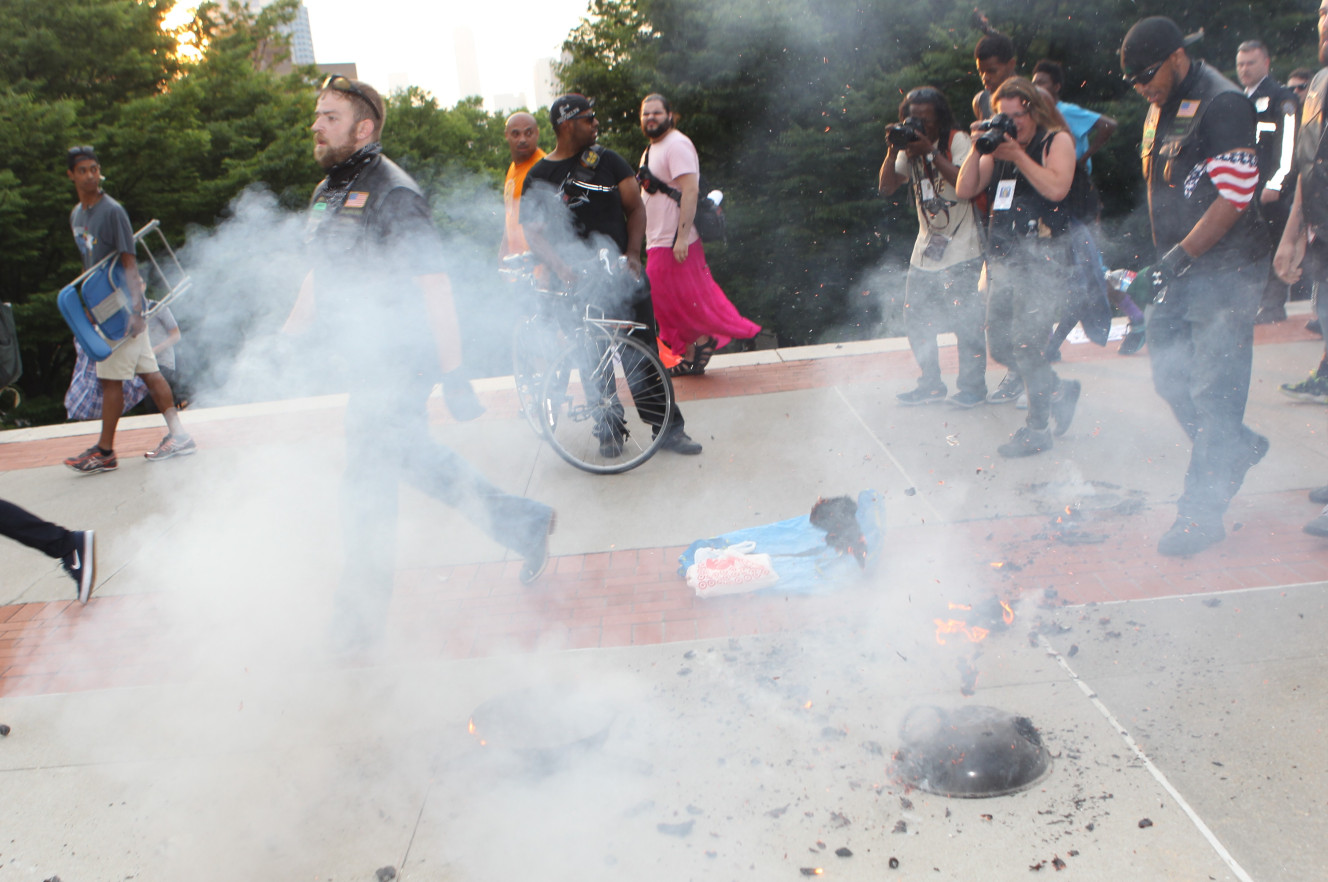 Protesters Burn Flag To Protest Cops, Need Cops To Save Them