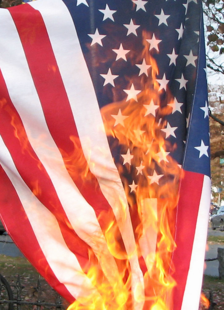 Man Sets Himself On Fire While Burning The American Flag Outside RNC