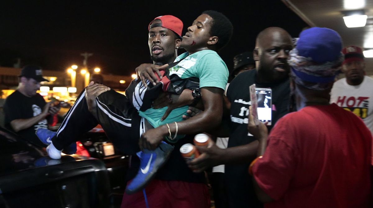Watch: Car Hits Protester At Ferguson Rally, Shots Fired