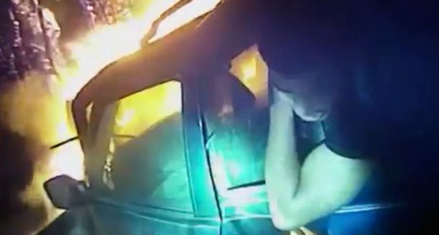 Watch Dramatic Footage: Police Officer Saves Man In Burning Car