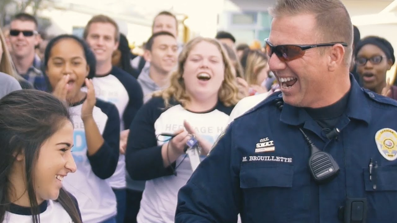 Watch: Massive Mob Overwhelm School's Favorite Police Officer