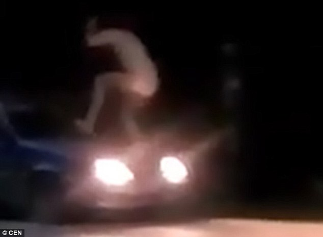 Watch:  Drunk, Naked Man Jump On Police Car