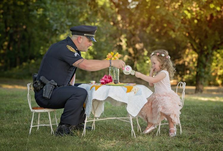 Police Officer Has Tea Party With Toddler One Year After Saving Her Life