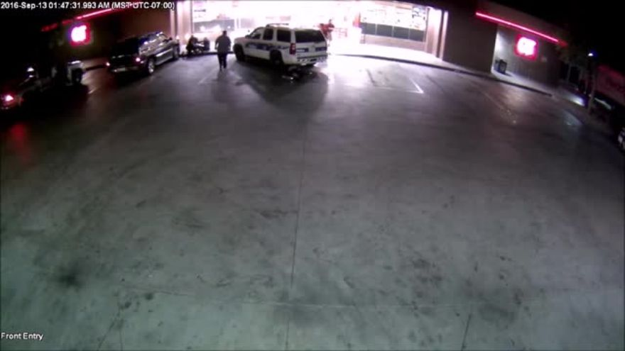 Watch: Police Officers Struck By Car In Convenient Store Parking Lot