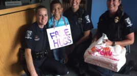 Charlotte Boy Gives Police Officers 'Free Hugs' In Midst Of Riots