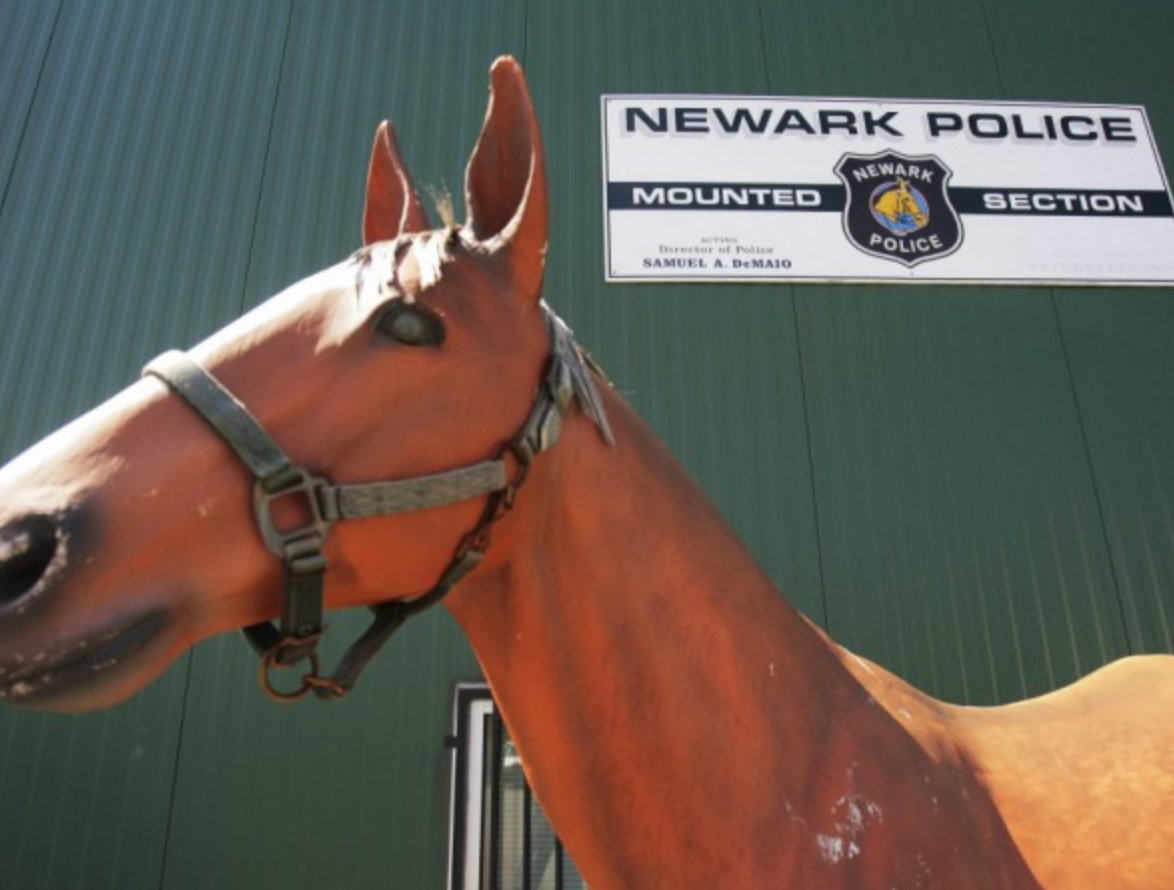 Mounted Police Corral 3 Gunfighters—On City Street in Newark