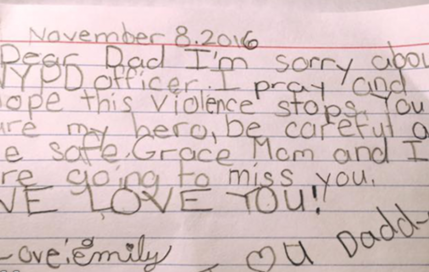 8-Year-Old Daughter's Note Offers Hope for Officers