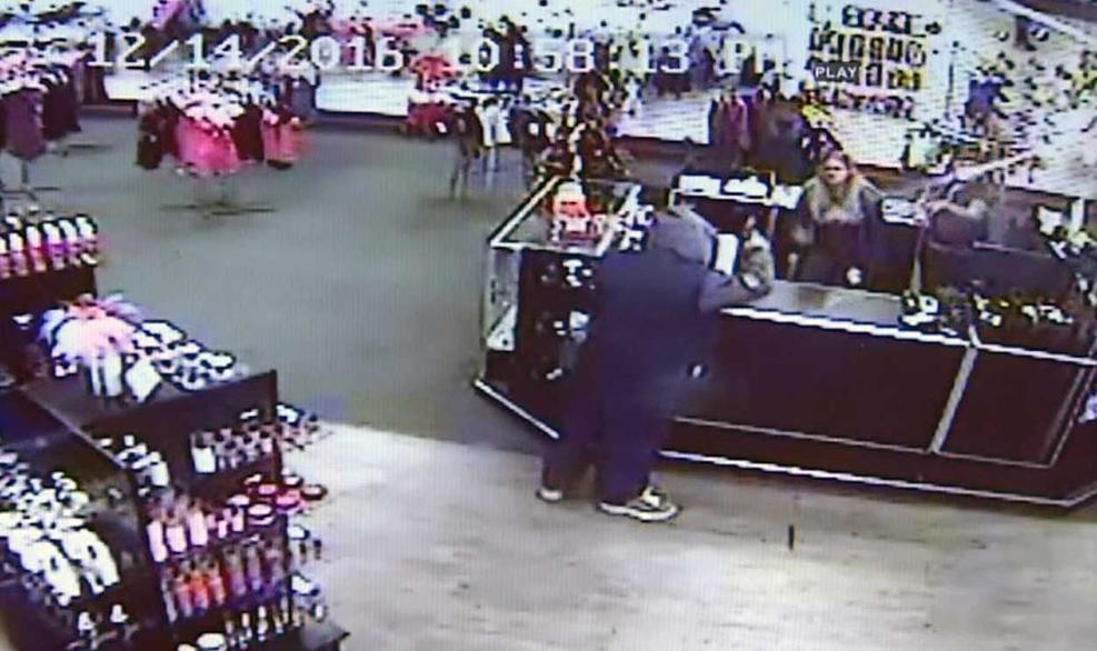 Watch:  Employees Fight Robber Using Sex Toys