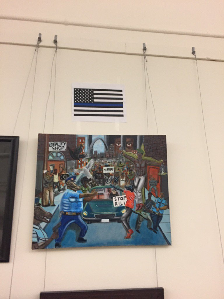 We Go High:  Thin Blue Line Flag Hung Above Racist Capital Painting