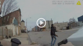 Watch Dramatic Baltimore Police Shooting During Foot Pursuit