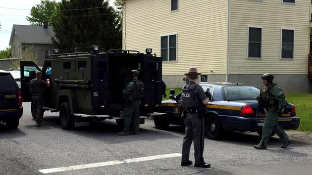 Cop shot in upstate NY, suspect barricaded in home