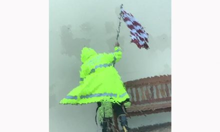 Police Officer Photographed Saving American Flag During Hurricane Harvey