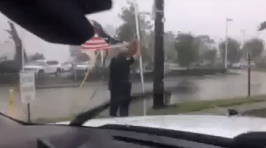 Police Lieutenant Saves American Flag In Hurricane Irma
