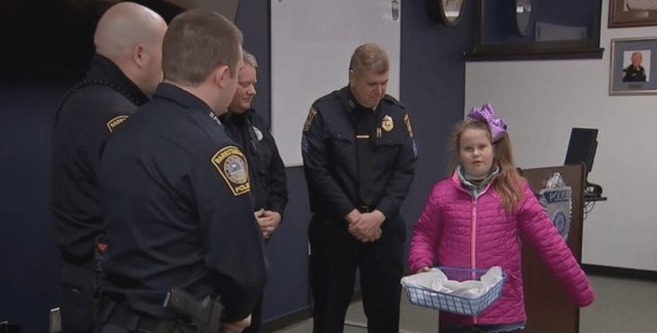8 Year Old Girl Giving Out Medals To Honor Fallen Officers
