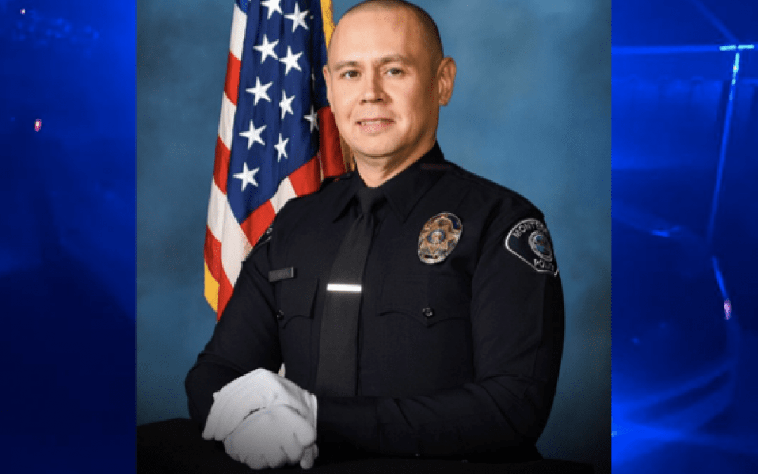 Officer dies after being shot with own gun at police station