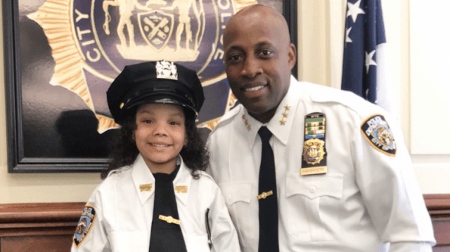 Miracle girl who survived father's suicide jump in subway visits NYPD