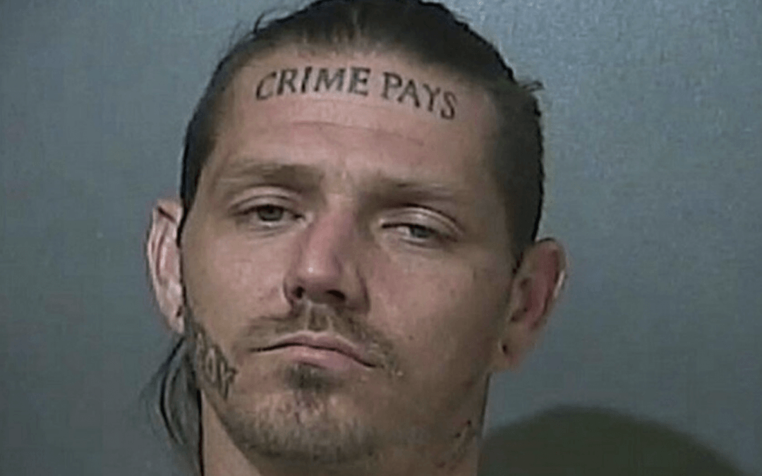 Indiana police looking for man with 'Crime Pays' tattooed on forehead